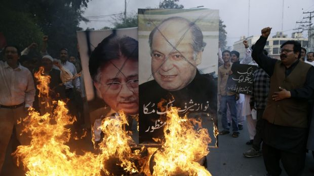Protesters burn pictures of Pakistani political leaders past and present in Lahore before this week's attack. Pakistan ...