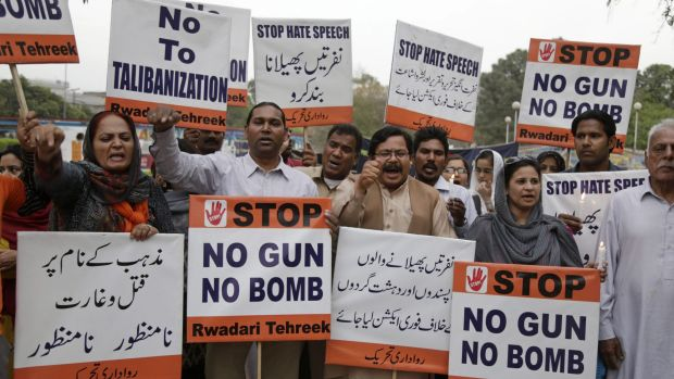 Pakistani civil society activists condemn Sunday's suicide bombing in a park in Lahore.