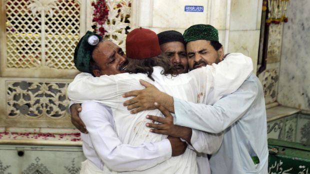 Family members of victims comfort each other after suicide bombers attacked the Data Durbar shrine in Lahore in July 2010.
