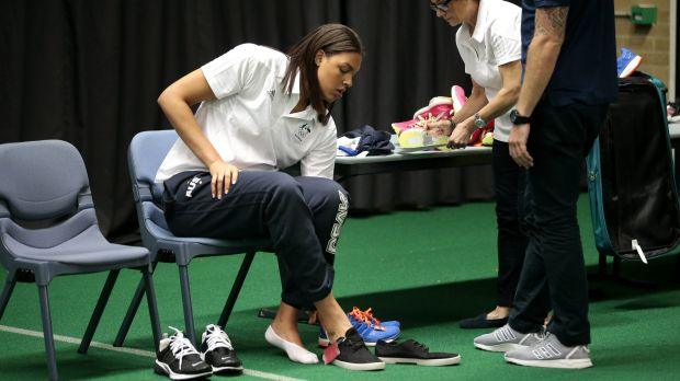 Opals player Liz Cambage tries on some shoes at the AIS on Tuesday.