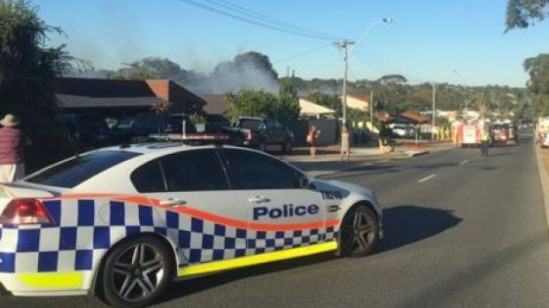 Police have closed sections of Beach Road due to a house fire.