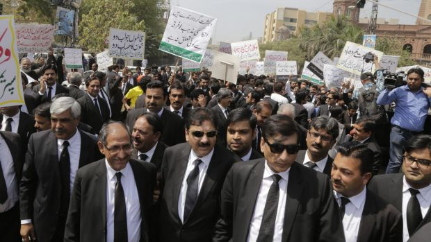 Pakistani lawyers and traders rally to condemn a Sunday suicide attack that targeted Christians gathered for Easter in ...