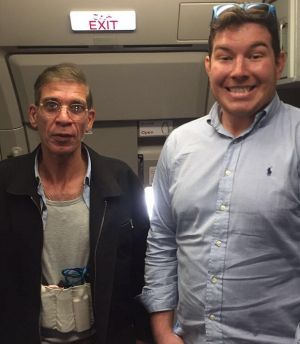 Ben Innes, right, poses for a photo with hijacker Seif Eldin Mustafa.