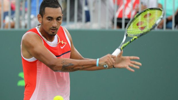 Nick Kyrgios returns the ball to Andrey Kuznetsov.