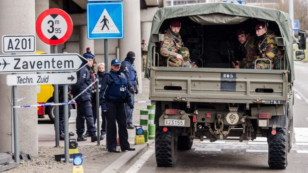 Belgian police and soldiers secure the area outside Zaventem Airport in Brussels on Tuesday.