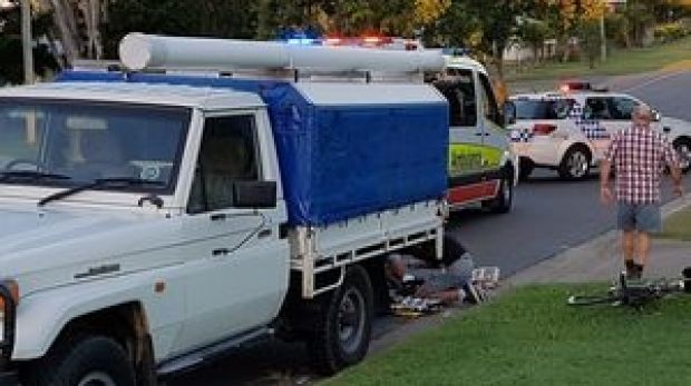 A cyclist dies after colliding with a parked ute in Hervey Bay.