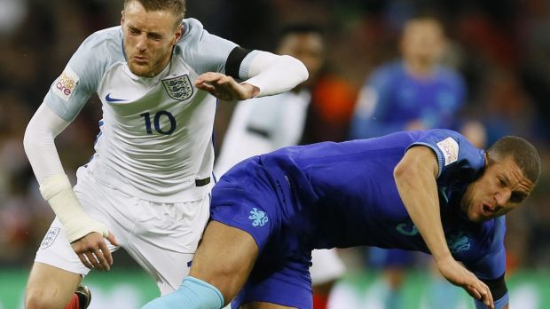 England's Jamie Vardy, left, is fouled by Netherlands' Jeffrey Bruma at Wembley.