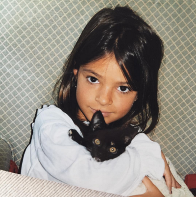 "Emily Ratajkowski shared this picture of her younger self with ""baby kitty"" to her Instagram account earlier this week."