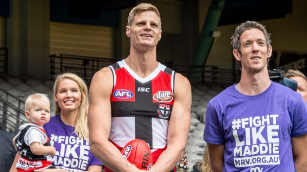 On a mission: St Kilda captain Nick Riewoldt with Bulldogs captain Bob Murphy and his wife Catherine and son James.