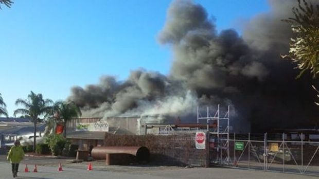 The factory engulfed in flames.