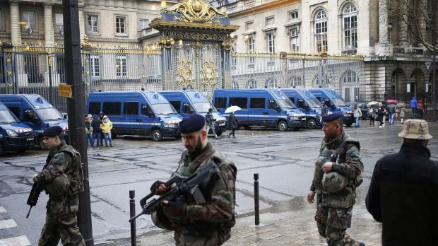 French soldiers patrol outside the Paris Hall of Justice on Wednesday while Reda Kriket is questioned inside.