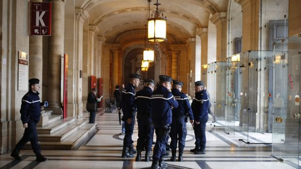 French gendarmes patrol in the Paris hall of Justice  on Wednesday while Frenchman Reda Kriket is questioned by a magistrate.