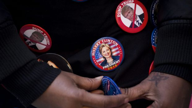 An attendee wears campaign buttons before the start of an event with Hillary Clinton in New York on Wednesday.