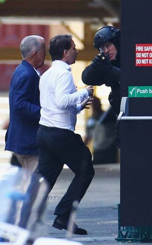 John O'Brien and Stefan Balafoutis flee from the Lindt cafe during the siege.