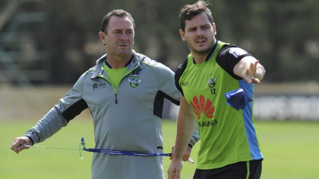 Talking tactics: Aidan Sezer chats to Canberra Raiders coach Ricky Stuart.