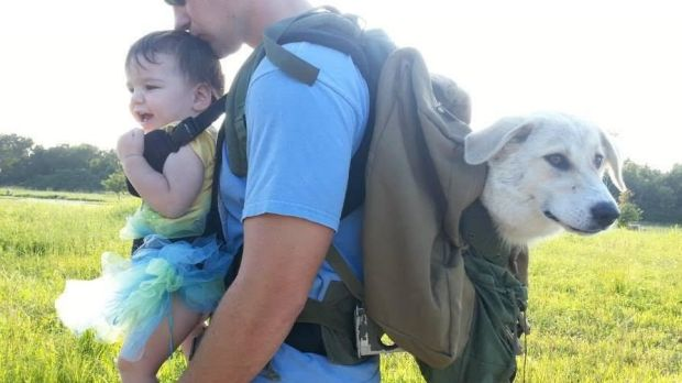 Former US Marine Eric Yarger Snickle Fritz and daughter Charlotte on a fundraising walk. Fritz is a constant companion ...