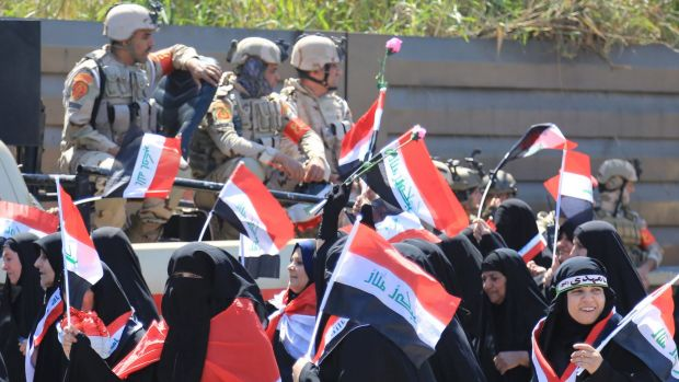 Iraqi soldiers watch over a women's rally in solidarity with Sadr supporters earlier this week.