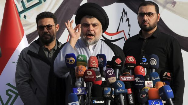 Muqtada al-Sadr speaks to his supporters and regional and international media before entering the Green Zone on March 27.