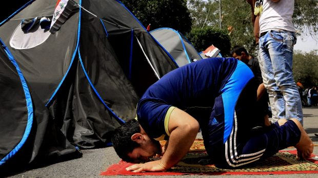 A Sadr supporter takes time to pray at a protest camp on the edge of the Green Zone.