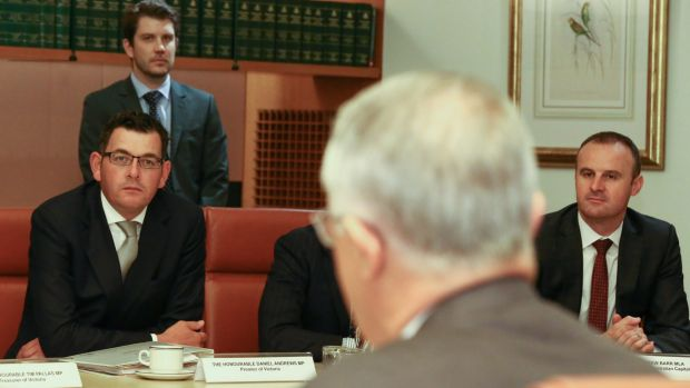 ACT Chief Minister Andrew Barr, right, listens to Mr Turnbull address COAG in April.