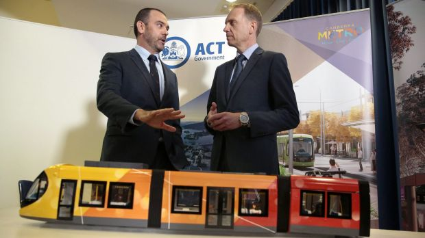 Canberra Metro Consortium chairman Mark Lynch and deputy chief minister Simon Corbell earlier this month.