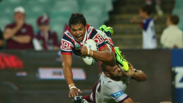 Flying high: Latrell Mitchell scores against Manly at the Roosters' home ground.