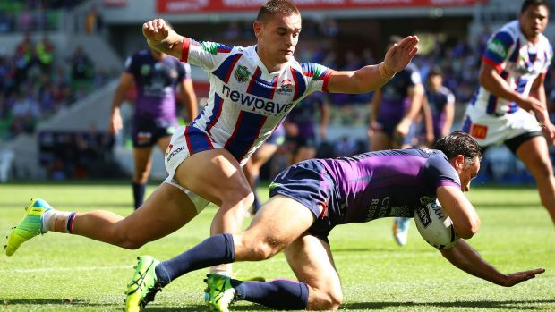 Cooper Cronk of the Storm scores a try againt the Newcastle Knights at AAMI Park.