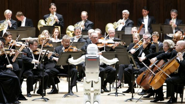Mechanical maestro: a robot conducts an orchestra.