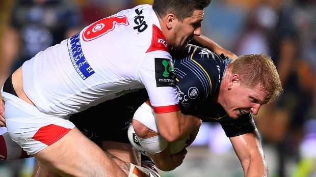 Brute force: Ben Hannant is tackled by Gareth Widdop.