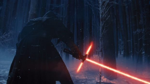 Kylo Ren wields his lightsaber in <i>Star Wars: The Force Awakens</i>.
