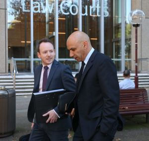Moses Obeid, right, leaves the Federal Court.