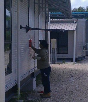 A worker removes graffiti that likened the Australian Border Force to Nazi forces.