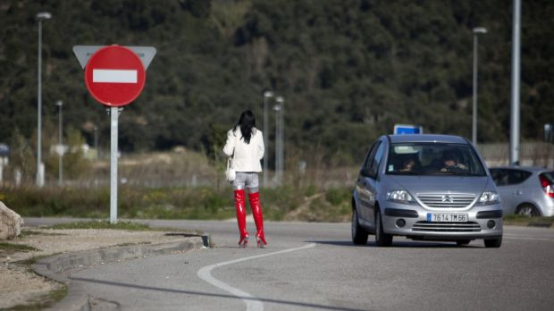 Prostitutes waiting for clients on the roadside are a common sight in France where brothels are