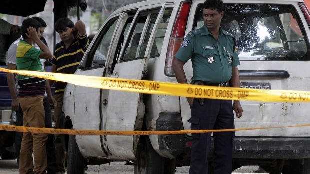 Bangladeshi police at the site where Italian citizen Cesare Tavella was gunned down by unidentified assailants in Dhaka ...