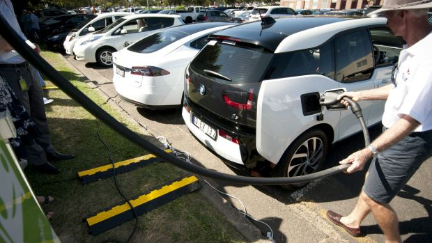 Electric car owner Gary Crighton fills up at UQ St Lucia's electric vehicle charging station.