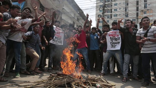 Bangladeshi students protest seeking the arrest of three motorcycle-riding assailants who hacked student activist ...