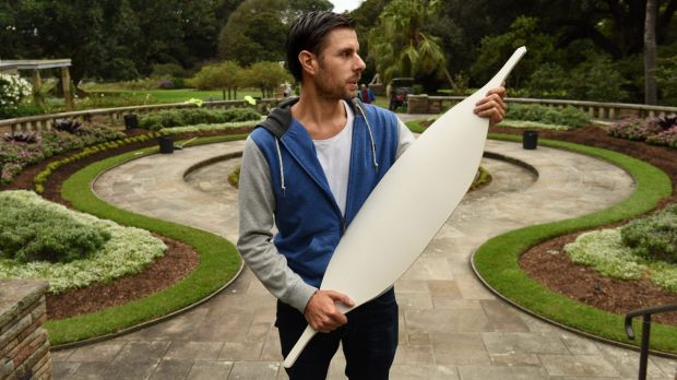 Artist Jonathan Jones holds one of the 15,000 ceramic Aboriginal shields that will outline the lost Garden Palace in the ...