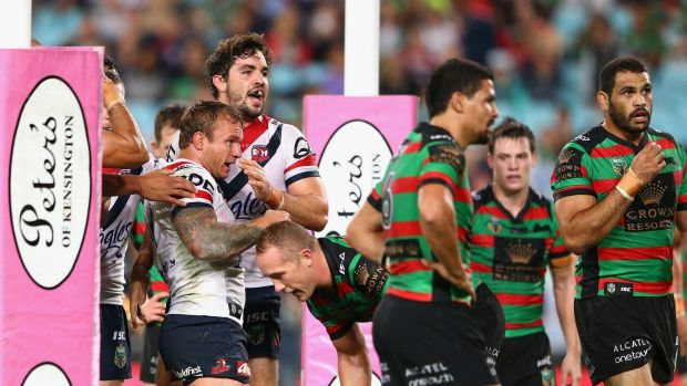 Four-pointer: Aiden Guerra of the Roosters celebrates a try with teammate Jake Friend.