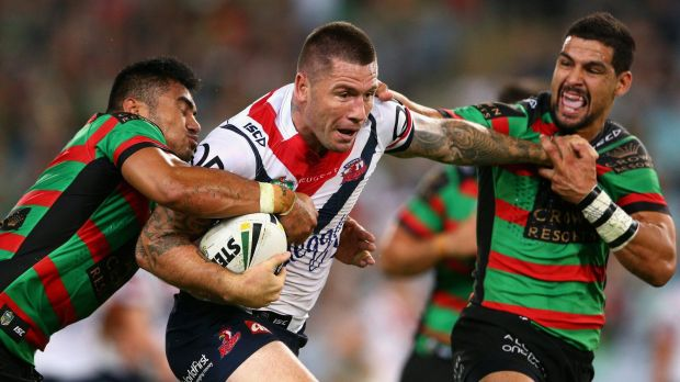 Big man running: Shaun Kenny-Dowall of the Roosters takes on the South Sydney defence.