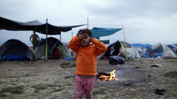 A migrant child at the northern Greek border point of Idomeni, Greece.