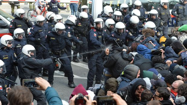 Police use pepper spray on protesters in the village of Brenner on the Italian-Austrian border.