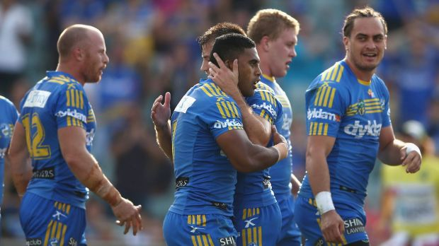 Michael Jennings celebrates with his Eels teammates after scoring a try against the Raiders.