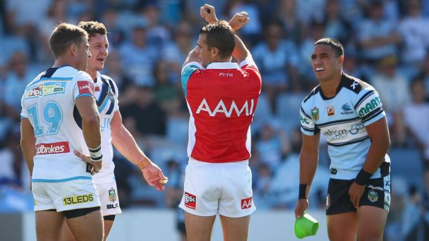 On report: Referee Grant Atkins reprimands Greg Bird.