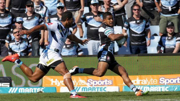 Catch me if you can: Ben Barba goes in to score for the Sharks.