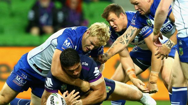 Jesse Bromwich of the Storm is tackled.