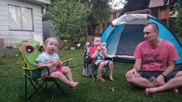 Eliza, 2, Lincoln, 4 and dad Martin Swinburn in the backyard of their Asquith home, which will likely be demolished and ...