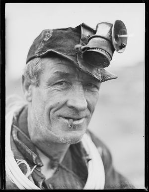 Miner wearing a headlamp at the Lithgow Colliery, near Sydney, in December 1932.