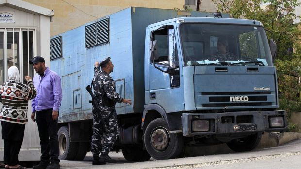 A police truck transports Sally Faulkner and Channel 9 presenter Tara Brown to Baabda Women's Prison in south-eastern ...