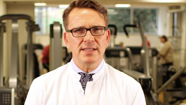 Why is a dentist in a gym? Professor Jorg Eberhard says gum disease could erase the benefits of sport.