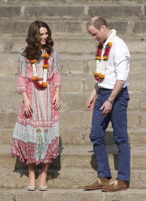 The Duke and Duchess of Cambridge, Prince William, and his wife, float flowers at the Banganga Water Tank in Mumbai, ...